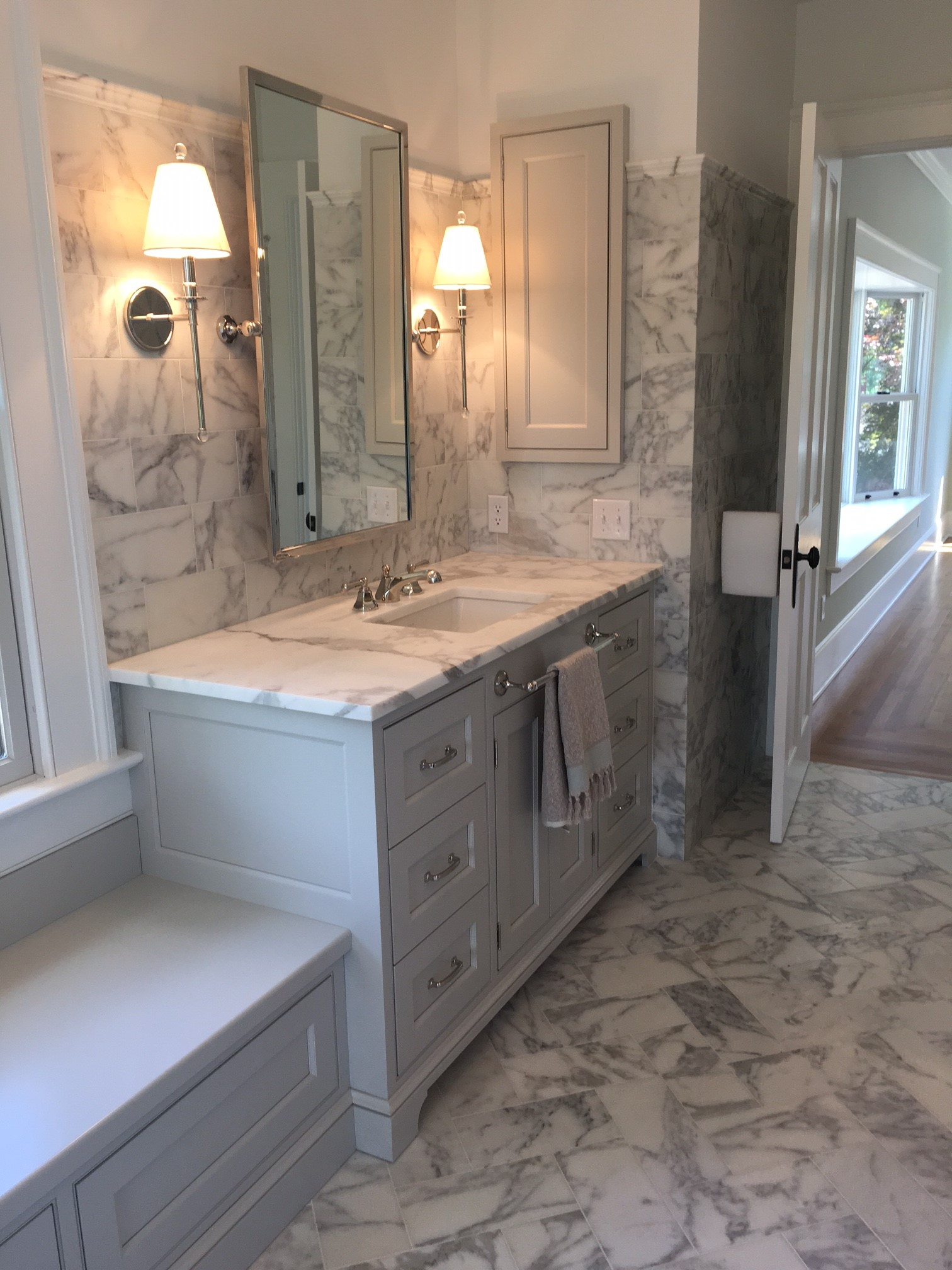 The Solid Color Paint On Superior Woodcraft Vanity Provides An Anchor Point In Middle Of Beautiful Stone Work With Lots Movement