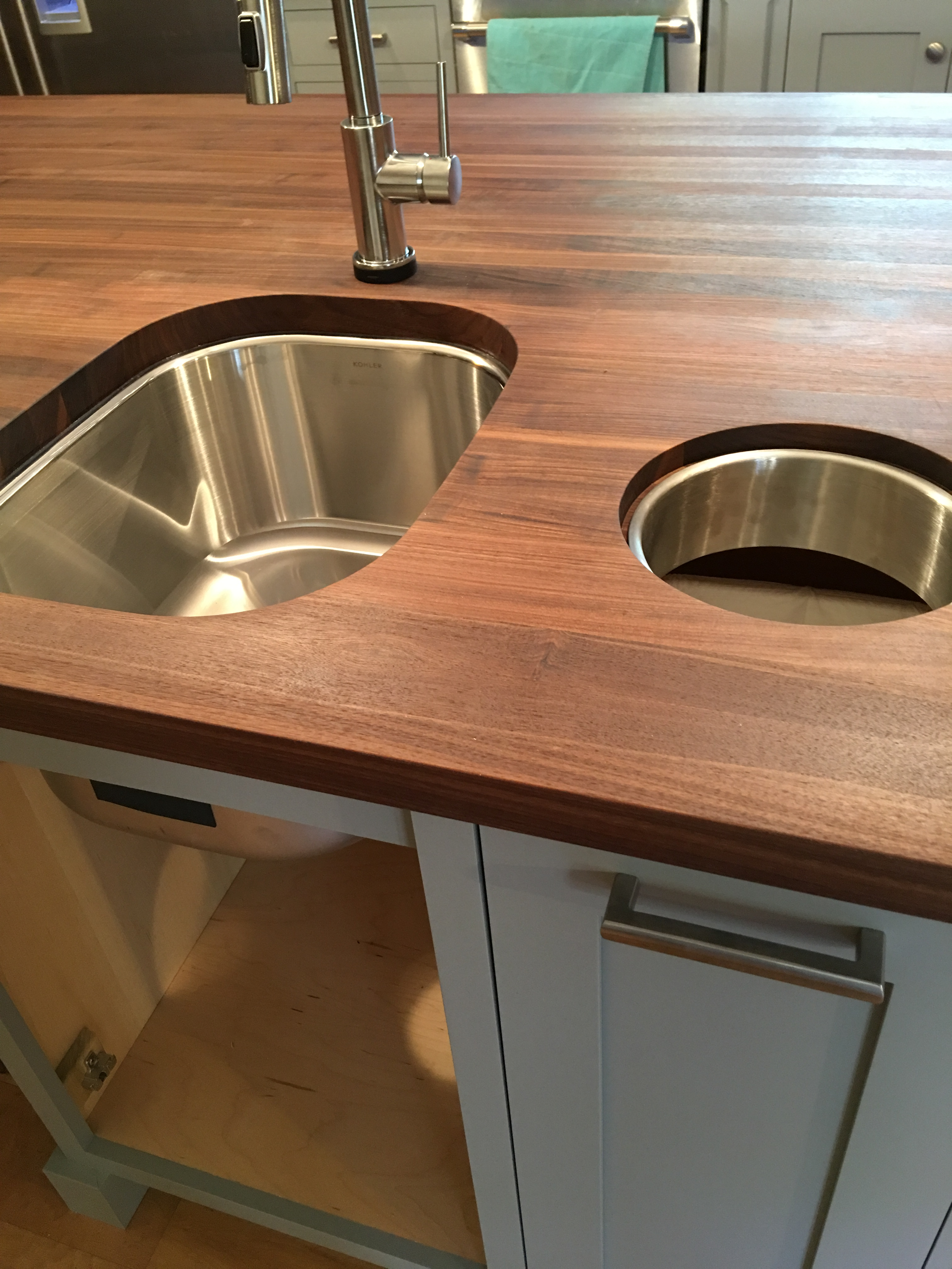 Stainless Steel Sink And Custom Trash Chute In Custom Made Kitchen Island  With Oiled Walnut Counter Top